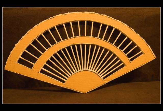 wonderful-decorative-fan-from-newspaper-tubes-18