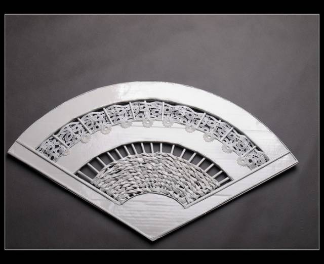 wonderful-decorative-fan-from-newspaper-tubes-8
