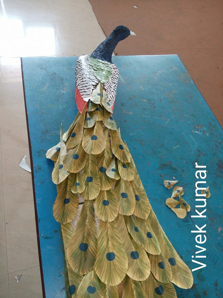 How to make peacock wall art from waste paper craft for Waste paper wall hanging